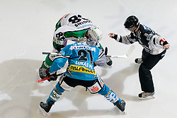 Philipp Lukas (EHC Liwest Black Wings Linz, #21) and Matt Higgins (HDD Tilia Olimpija, #88) during ice-hockey match between HDD Tilia Olimpija and EHC Liwest Black Wings Linz in 37th Round of EBEL league, on Januar 9, 2011 at Hala Tivoli, Ljubljana, Slovenia. (Photo By Matic Klansek Velej / Sportida.com)