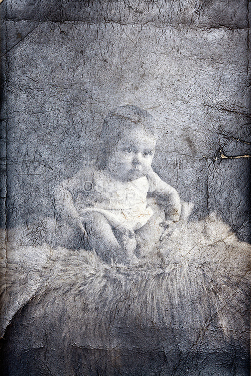 deteriorating photo surface with a baby