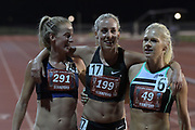 May 2, 2019; Stanford, CA, USA; Melbourne Track club teammates Ellie Pashley (291), Susan Krumins (199) of Melbourne Track Club and Camille Buscomb (49)  embrace after the women's 10,000m  the 24th Payton Jordan Invitational at Cobb Track & Angell Field.