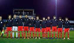 RHYL, WALES - Wednesday, November 14, 2018: Wales' players stand for the national anthem before the UEFA Under-19 Championship 2019 Qualifying Group 4 match between Wales and Scotland at Belle Vue. L-R: captain Ryan Reynolds, goalkeeper George Williams, Brandon Cooper, Ben Cabango, Joseph Adams, Luke Jephcott, Daniel Griffiths, Brennan Johnson, Morgan Boyes, Neco Williams, Dylan Levitt. (Pic by Paul Greenwood/Propaganda)