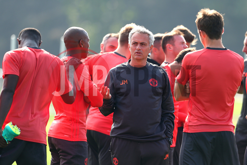 Manchester United manager Jose Mourinho talks with Ashley Young and Michael Carrick - Mandatory by-line: Matt McNulty/JMP - 14/09/2016 - FOOTBALL - Manchester United - Training session ahead of Europa League Group A match against Feyenoord