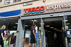 © Licensed to London News Pictures. 05/08/2019. London, UK. Shoppers outside Tesco Express on Green Lanes, Haringey, north London. <br /> According to Tesco, it is to cut 4,500 jobs from its 153 Metro stores and 134 Express stores in latest round of redundancies. Photo credit: Dinendra Haria/LNP