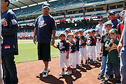 ANAHEIM, CA - JUNE 05:  Young baseball fans walk around the field during a Little League Days promotion before the Los Angeles Angels of Anaheim game against the New York Yankees on June 5, 2011 at Angel Stadium in Anaheim, California. The Yankees won the game 5-3. (Photo by Paul Spinelli/MLB Photos via Getty Images)