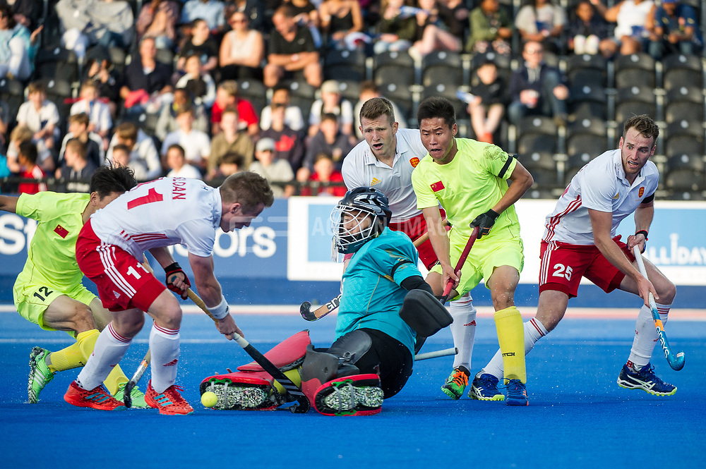 China's  Xiaoping Guo saves from Ian Sloan of England. England v China - Hockey World League Semi Final, Lee Valley Hockey and Tennis Centre, London, United Kingdom on 15 June 2017. Photo: Simon Parker