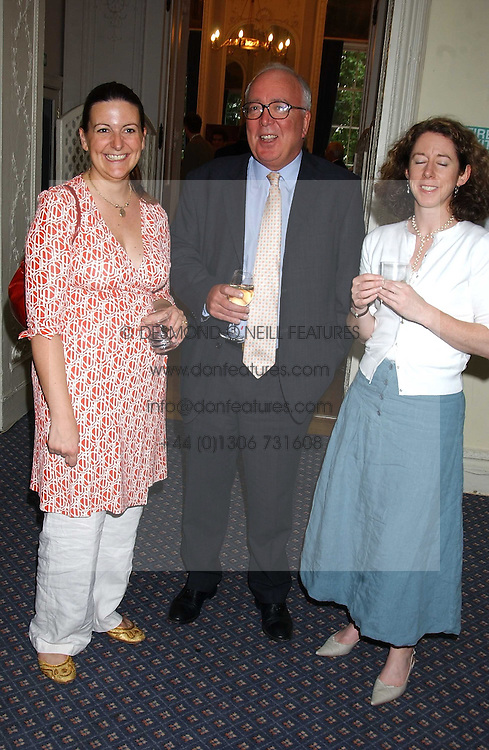 Left &amp; centre SOPHIE LAURIMORE and PETER ROCHE at a party to celebrate the publication of 'An Act of Peace' by Ann Widdecombe at 11 Carlton House Terrace, London on 19th July 2005.<br />
