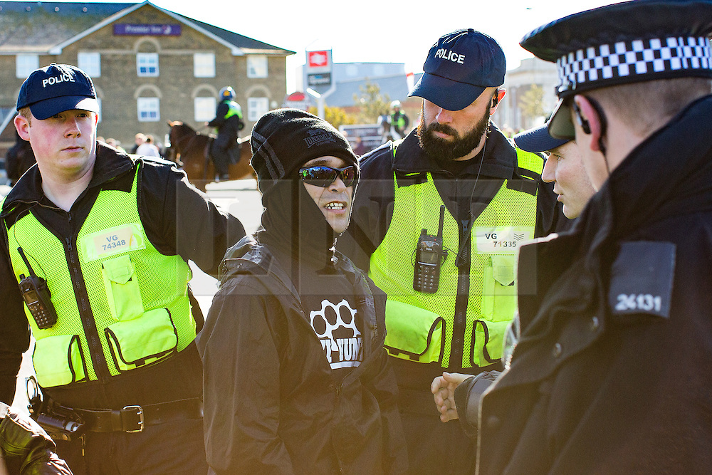 © Licensed to London News Pictures . 22/10/2016 . Margate , UK . Police detain an anti fascist protester . A White Lives Matter protest and march , opposed by antifascists , is held in Margate , Kent . Photo credit : Joel Goodman/LNP