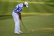 Australian golf professional Scott Hend drops his eagle putt on the 18th hole to lead after the third round during the BMW PGA Championship at the Wentworth Club, Virginia Water, United Kingdom on 28 May 2016. Photo by Simon Davies.