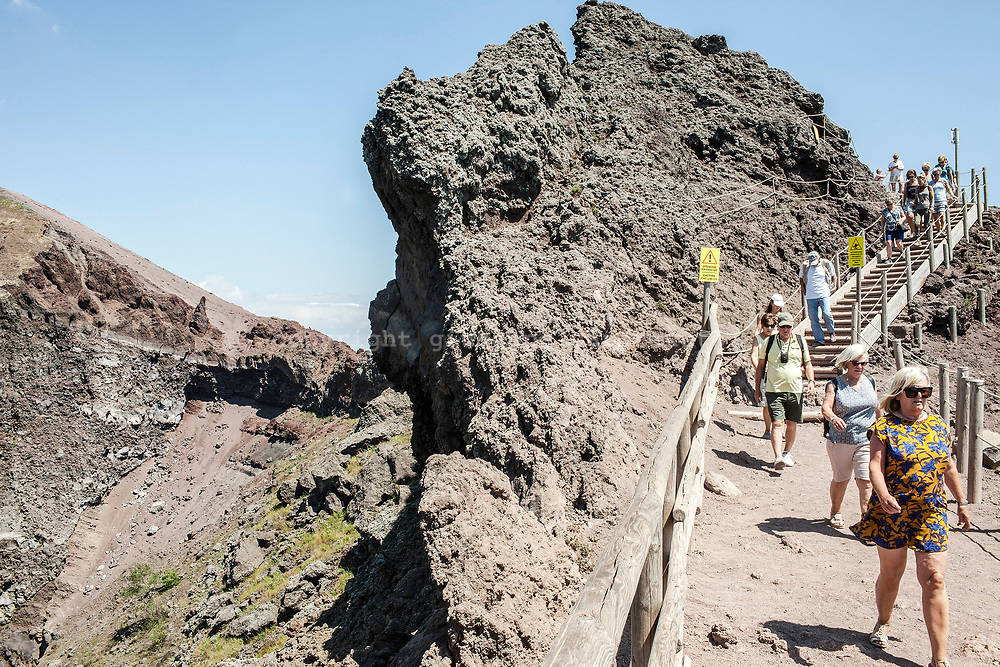 29 May 2017, Parco Nazionale del Vesuvio, Naples Italy - Tourists walk around the interior of the cone of the volcano Vesuvius.