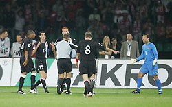 WARSAW, POLAND - WEDNESDAY, SEPTEMBER 7th, 2005: Wales' players argue with the referee after he awards Poland a dodgy penalty during the World Cup Group Six Qualifying match at the Legia Stadium. (Pic by David Rawcliffe/Propaganda)