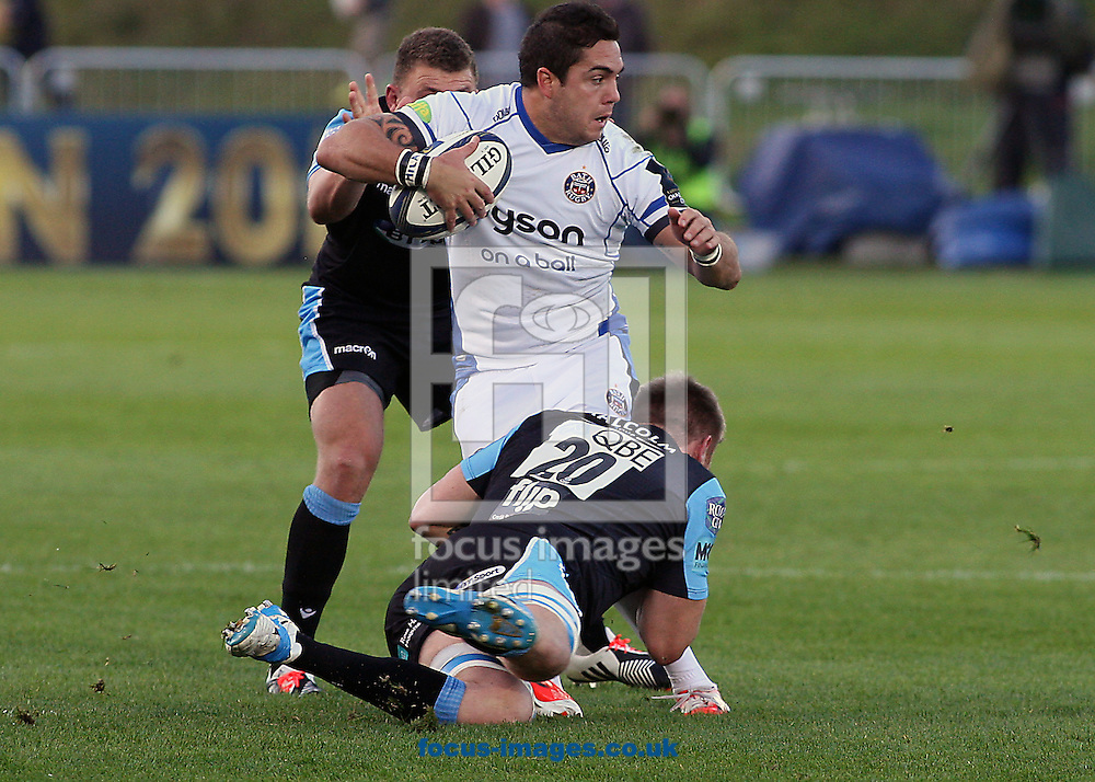 Tyrone Holmes of Glasgow Warriors and Horacio Agulla of Bath Rugby during the European Rugby Champions Cup match at Scotstoun Stadium, Glasgow<br /> Picture by Ian Buchan/Focus Images Ltd +44 7895 982640<br /> 18/10/2014