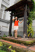 A young lady exploring the Ho Chi Minh City Museum (former Vice Presidential palace).