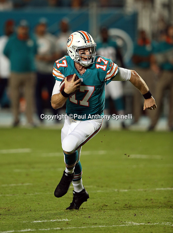 Miami Dolphins quarterback Ryan Tannehill (17) runs for a first quarter keeper good for a first down during the NFL week 14 regular season football game against the New York Giants on Monday, Dec. 14, 2015 in Miami Gardens, Fla. The Giants won the game 31-24. (©Paul Anthony Spinelli)