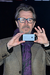 Gary Oldman arrives at the RoboCop World Premiere at The BFI IMAX in London,UK.<br /> Wednesday, 5th February 2014. Picture by Ben Stevens / i-Images