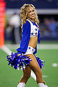 ARLINGTON, TX - OCTOBER 6:  Cheerleader of the Dallas Cowboys performs during a game against the Green Bay Packers at AT&T Stadium on October 6, 2019 in Arlington, Texas.  The Packers defeated the Cowboys 34-24.  (Photo by Wesley Hitt/Getty Images) *** Local Caption ***