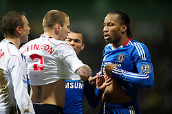 BOLTON, ENGLAND - Monday, January 24, 2011: Chelsea's Didier Drogba exposes himself to Bolton Wanderers' Gretar Steinsson after feigning injury to win a free-kick during the Premiership match at the Reebok Stadium. (Photo by David Rawcliffe/Propaganda)