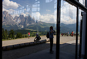 Hikers at the top of the cable car station at Piz Sorega, above the South Tyrolean town of Ortisei-Sankt Ulrich in the Dolomites, Italy.
