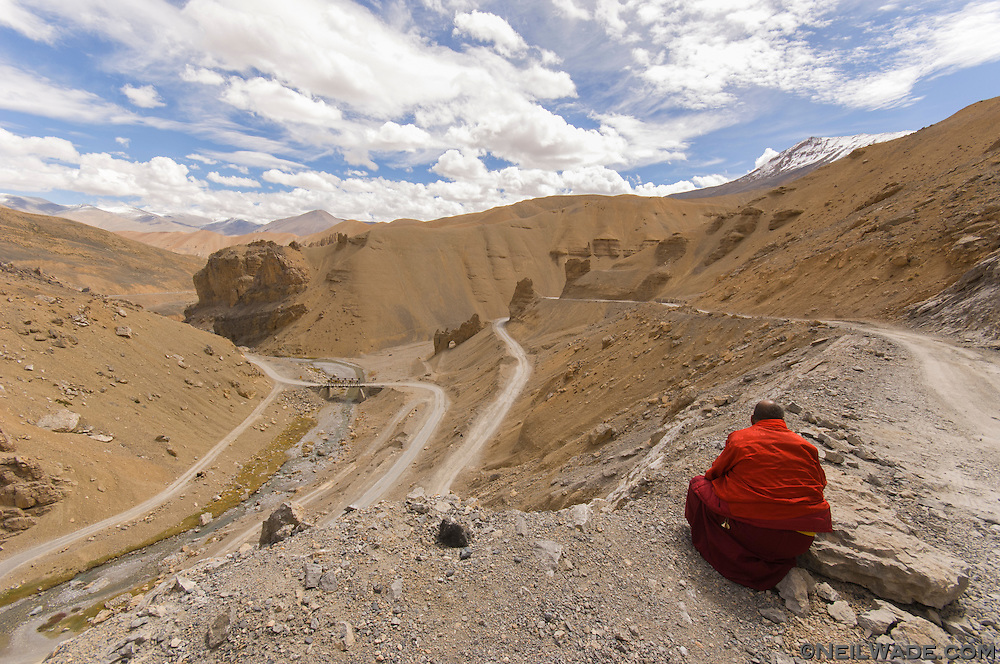 It's probably not too hard for you to figure out what this monk is doing in this remote, treeless landscape.