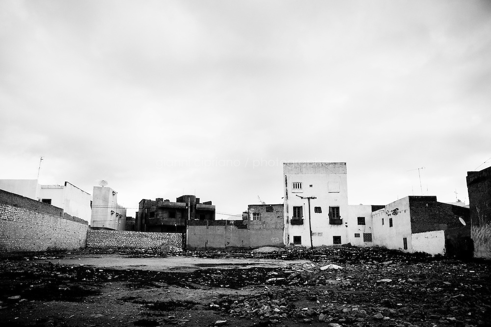 Kairouan, Tunisia - 18 December, 2011: Houses in the degraded outskirts of Kairouan, Tunisia on 18 December, 2011. Said Ferjani, 57, senior member of the political and communication bureau of the Nahda (Renaissance) party, started his activism in the Negra mosque of his hometown Kairouan when he was 16 years old, debating on politics, philosophy, economy and world events. In 1989 former dictator Zine El Abidine Ben Ali turned against Nahda (or Ennahda) and jailed 25,000 activists. Said Ferjani was jailed and tortured. He then flew Tunisia and moved to the UK. He came back to Tunisia after 22 years, after former dictator Ben Ali flew the country.<br /> <br /> Gianni Cipriano for The New York Times