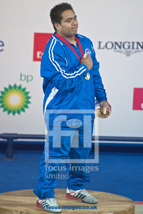 David Katoatau of Kiribati pictured on the podium after winning his country's first ever medal after winning the Men's 105kg final on Weightlifting Day Seven at Clyde Auditorium during Glasgow 2014 Commonwealth Games <br /> Picture by Ian Wadkins/Focus Images Ltd +44 7877 568959<br /> 30/07/2014