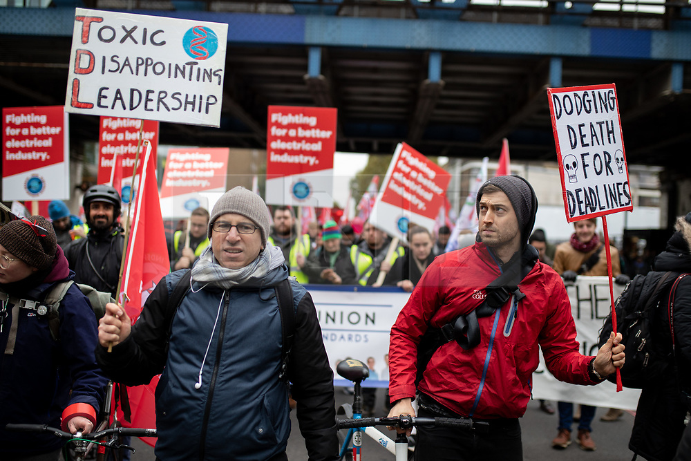 © Licensed to London News Pictures. 30/10/2018. London, UK. The Independent Workers Union of Great Britain set off from TfL offices on the employments rights demonstration titled 'Rise of the Precarious Workers'. The demonstration starts at Transport for London, passing the Royal Courts of Justice - where the IWGB is currently fighting  a case against Uber - and ends at the University of London. Photo credit : Tom Nicholson/LNP