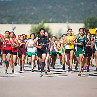 Varsity girls begin the 5000 meter run Saturday morning at the Heartbreak Classic cross county meet in Navajo.