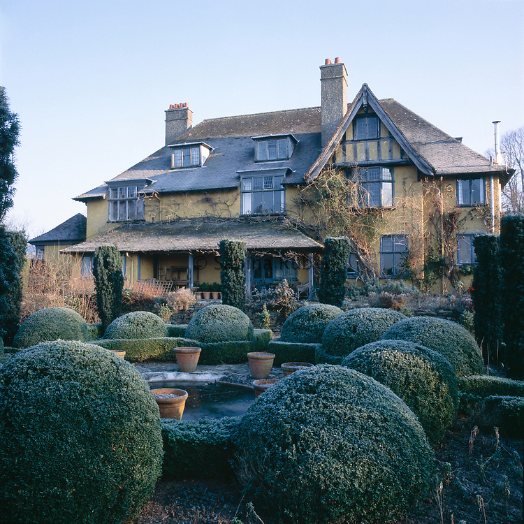 Bryan's Ground, Herefordshire - winter view of the house across the Sunken Garden with topiary