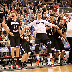 The Highland High School bench reacts to a score and a foul late in the fourth quarter of the finals of the 5A state basketball tournament against Madison High School at the Ford Idaho Center in Nampa, Idaho. Highland defeated Madison 65-55. Saturday March 5, 2016