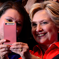 Democratic presidential candidate  Hillary Clinton takes a selfie photo with a supporter as she departs the David L. Lawrence Convention Center in Pittsburgh as part of their bus tour following the Democratic Convention on July 30, 2016.   Photo by Archie Carpenter/UPI