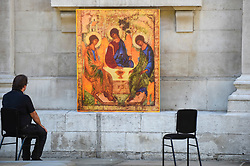 © Licensed to London News Pictures. 25/06/2020. LONDON, UK.  A visitor sits in the new outdoor Prayer Garden in the courtyard of St Martin-in-the-Fields, Trafalgar Square, where all are welcome to meditate, pray and discover peace and stillness at the heart of London.  The UK government has relaxed coronavirus pandemic lockdown restrictions allowing churches and other places of worship to open for private prayer from 15 June and, in the latest change, collective worship and communal prayer will be allowed from 4 July.  Currently, many churches are offering online services to their congregations. Photo credit: Stephen Chung/LNP