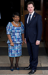 © London News Pictures. 22/04/2013. London, UK.  Deputy Prime MInister NICK CLEGG being greeted by DOREEN LAWRENCE, Mother of Stephen Lawrence as he arrives at a memorial service at St Martins in the Field Church in London marking the 20 anniversary of the murder of Stephen Lawrence. Stephen Lawrence was murdered in a racist attack while waiting for a bus in SOuth London on the evening of 22 April 1993. Photo credit : Ben Cawthra/LNP