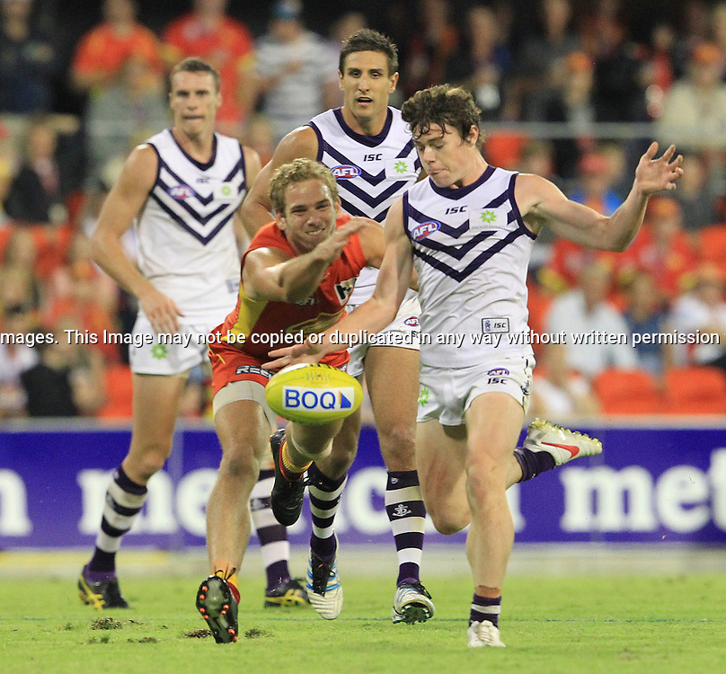 AFL - ROUND 6 - GOLD COAST SUNS v FREMANTLE DOCKERS. Action from the 2012 Australian Football League (AFL ) clash at Metricon Stadium Queensland, between the Gold Coast Suns v Fremantle Dockers - 5th May 2012. This image is for Editorial Use Only. Any further use or individual sale of the image must be cleared by application to the Manager Sports Media Publishing (SMP Images). PHOTO : SCOTT POWICK SMP IMAGES