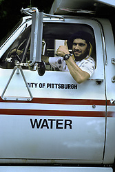 Americana City of Pittsburgh water department truck driver workergives thumbs up sign