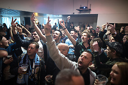 "© Licensed to London News Pictures . 07/04/2018. Manchester, UK. Manchester City go 2-0 up . Manchester City fans watch the Manchester Derby between Manchester City and Manchester United , on a live screen , at "" Manchester Bar 1 "" pub , situated directly opposite the Etihad Stadium . Photo credit : Joel Goodman/LNP"