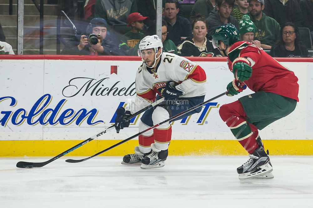 Dec 13, 2016; Saint Paul, MN, USA; Florida Panthers forward Vincent Trocheck (21) carries the puck during the first period against the Minnesota Wild at Xcel Energy Center. Mandatory Credit: Brace Hemmelgarn-USA TODAY Sports