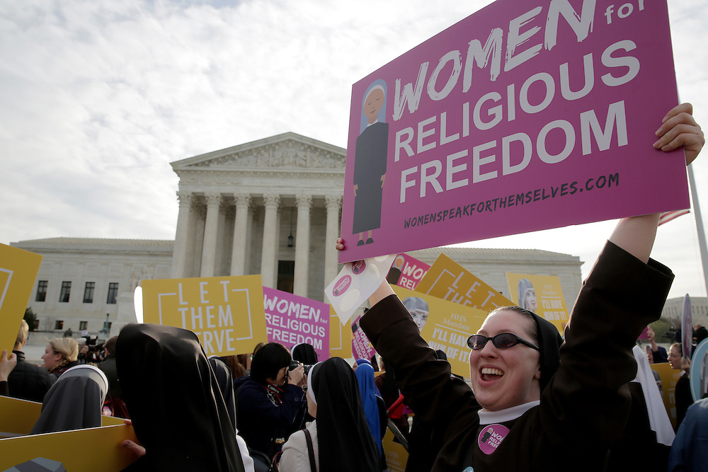 Nuns rally before Zubik v. Burwell, an appeal brought by Christian groups demanding full exemption from the requirement to provide insurance covering contraception under the Affordable Care Act, is heard by the U.S. Supreme Court in Washington March 23, 2016.      REUTERS/Joshua Roberts