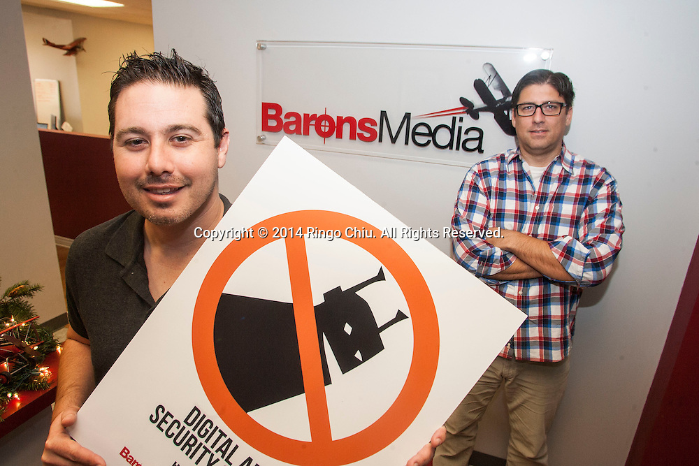 Jim Larkin and Daniel Kornblit, CEO and VP of Operations at Barons Media.<br /> Photo by Ringo Chiu/PHOTOFORMULA.com)
