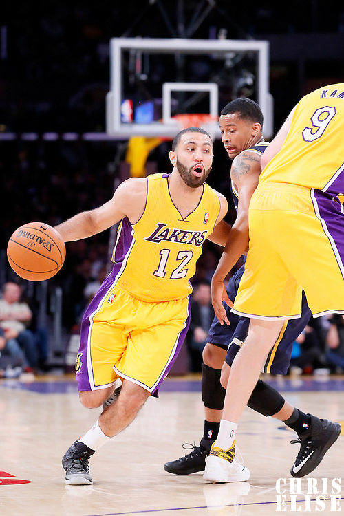 11 February 2014: Los Angeles Lakers point guard Kendall Marshall (12) drives past Utah Jazz point guard Trey Burke (3) during the Utah Jazz 96-79 victory over the Los Angeles Lakers at the Staples Center, Los Angeles, California, USA.