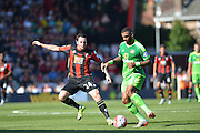 Sunderland AFC midfielder Yann M'Vila protects the ball from AFC Bournemouth's striker Lee Tomlin during the Barclays Premier League match between Bournemouth and Sunderland at the Goldsands Stadium, Bournemouth, England on 19 September 2015. Photo by Mark Davies.