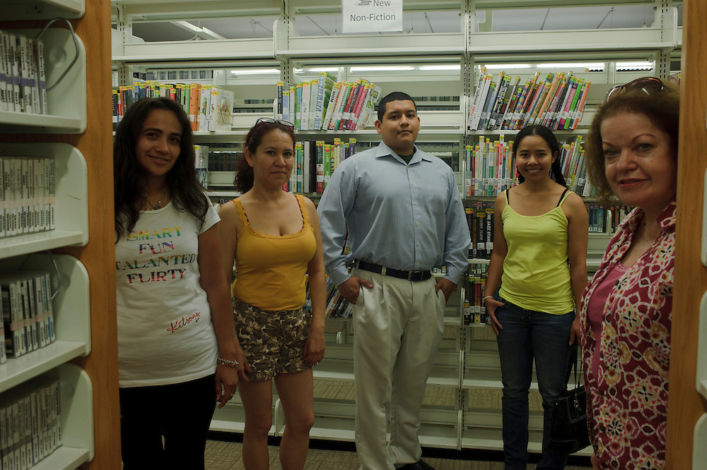 Blanca Moreno from El Salvador, Rosy Cruz from Honduras, Fernando Wong American-Ecuadorian (worker at the Library), Thanya Panseenual from Thailand and Constance Roscigno from Brentwood pose for the camera from their class break with their English Teacher Constance at the Brentwood Public Library. (July. 19, 2012)