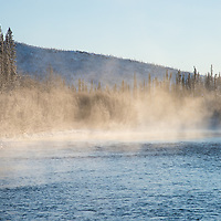 Morning fog on the Fishing Branch River near Bear Cave Mountain in the Yukon Territory, Canada.