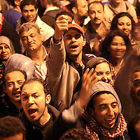 Anti government protesters celebrate inside Tahrir Square after the announcement of Egyptian President Hosni Mubarak's resignation in Cairo, Egypt. February 2011.