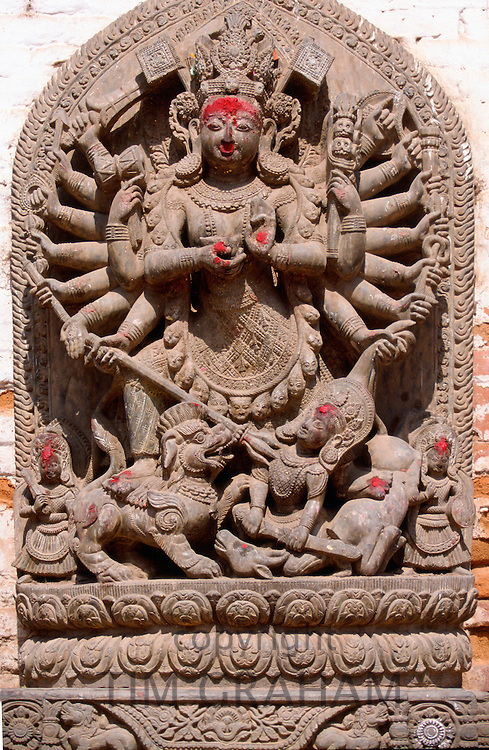 A stone carving of a religious icon in Nepal.