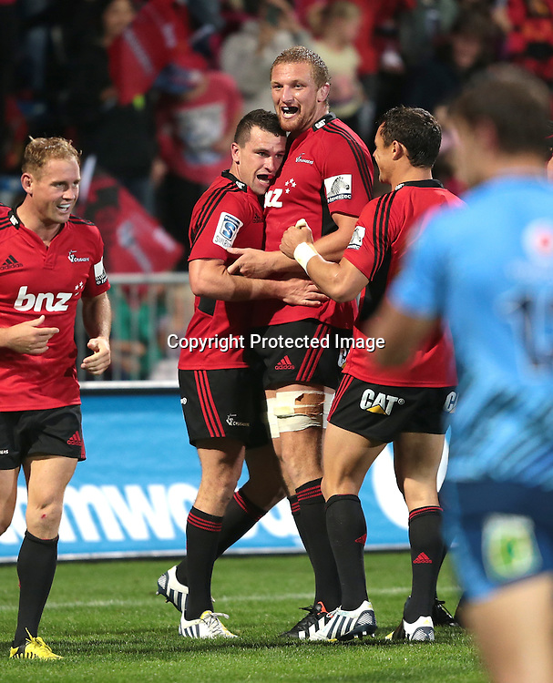 Crusaders celebrate after scoring during the Super Rugby match between the Crusaders and the Bulls at AMI Stadium on Saturday March 15, 2013 in Christchurch, New Zealand. Photo: Martin Hunter/Photosport