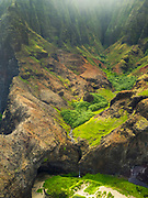 Aerial view of Kalalau Beach and the Na Pali coast, Kauai, Hawaii on a cloudy day.