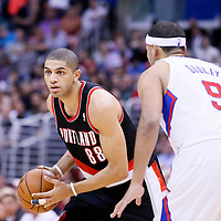 12 February 2014: Portland Trail Blazers small forward Nicolas Batum (88) looks to pass the ball over Los Angeles Clippers small forward Jared Dudley (9) during the Los Angeles Clippers 122-117 victory over the Portland Trail Blazers at the Staples Center, Los Angeles, California, USA.