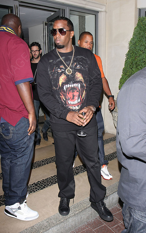 11.JULY.2011. LONDON<br /> <br /> AMERICAN RAPPER P DIDDY OUTSIDE THE SOHO HOTEL AND DINED AT THE ROKA RESTAURANT IN CENTRAL LONDON<br /> <br /> BYLINE: EDBIMAGEARCHIVE.COM<br /> <br /> *THIS IMAGE IS STRICTLY FOR UK NEWSPAPERS AND MAGAZINES ONLY*<br /> *FOR WORLD WIDE SALES AND WEB USE PLEASE CONTACT EDBIMAGEARCHIVE - 0208 954 5968*