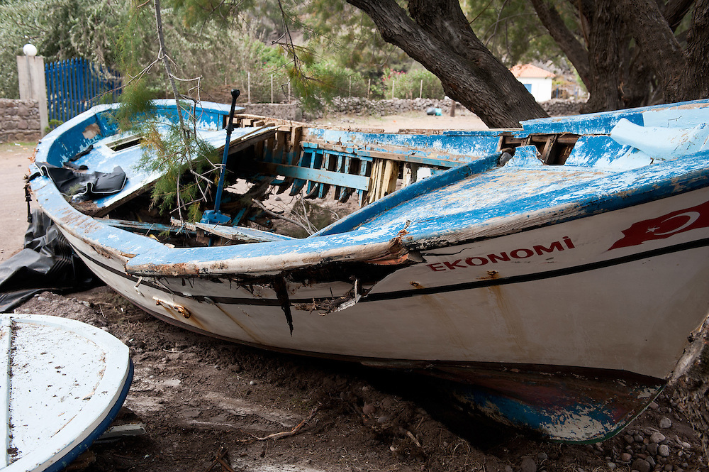 An old Turkish fishing boat at the beach of Kagia, near Skala Sikaminias on the northern shores of Lesvos, Greece. The majority of refugees and migrants use inflatable dinghies but in some cases the smugglers force people to use old boats that are farm more dangerous than the inflatable ones.