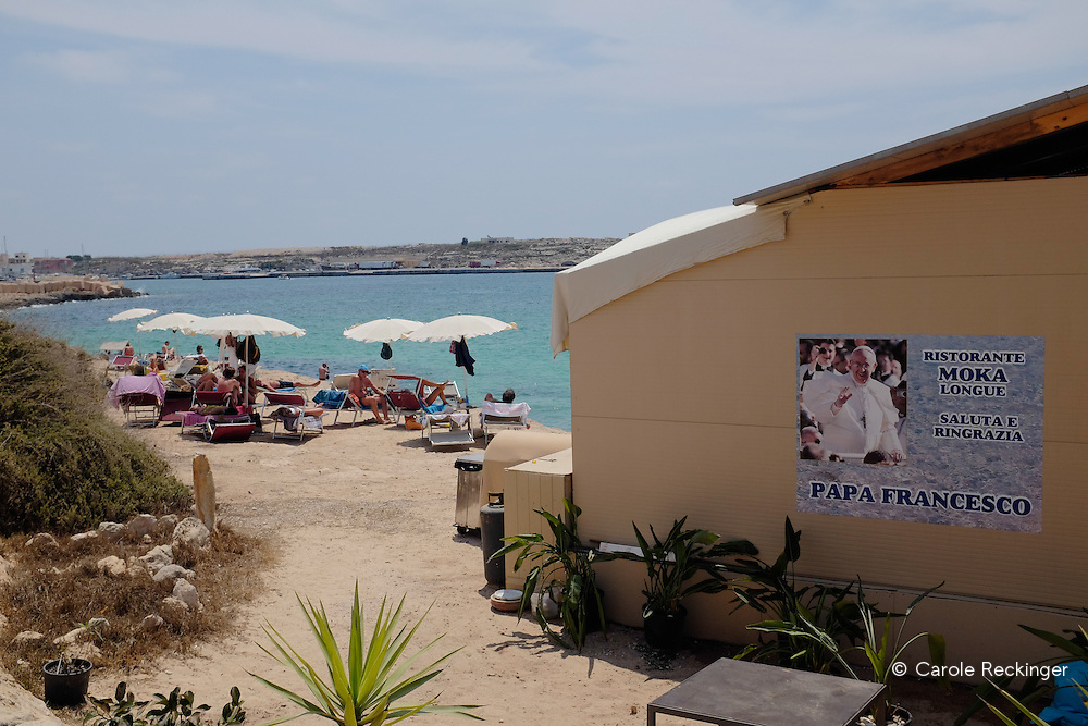 The visit of Pope Francis was a huge event in Lampedusa. Posters are still displayed all over the island