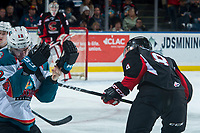 KELOWNA, CANADA - MARCH 14:   Jackson Leppard #8 of the Prince George Cougars high sticks Erik Gardiner #12 of the Kelowna Rockets into the boards in front of the vistor bench during third period on March 14, 2018 at Prospera Place in Kelowna, British Columbia, Canada.  (Photo by Marissa Baecker/Shoot the Breeze)  *** Local Caption ***