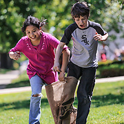 Fourth grade students Alexis Ramirez and Simon Wakely participate a potato sake tandem race during a year-end celebration at Washington Irving Elementary School in Oak Park , Friday, May 27, 2011. Photo by J.Geil.